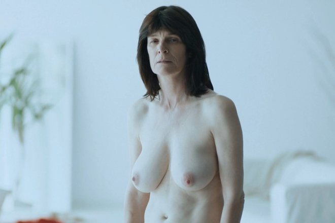 Laura Benson with naked chest in 'Touch Me Not'