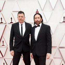 Atticus Ross y Trent Reznor en la alfombra roja de los Oscar 2021