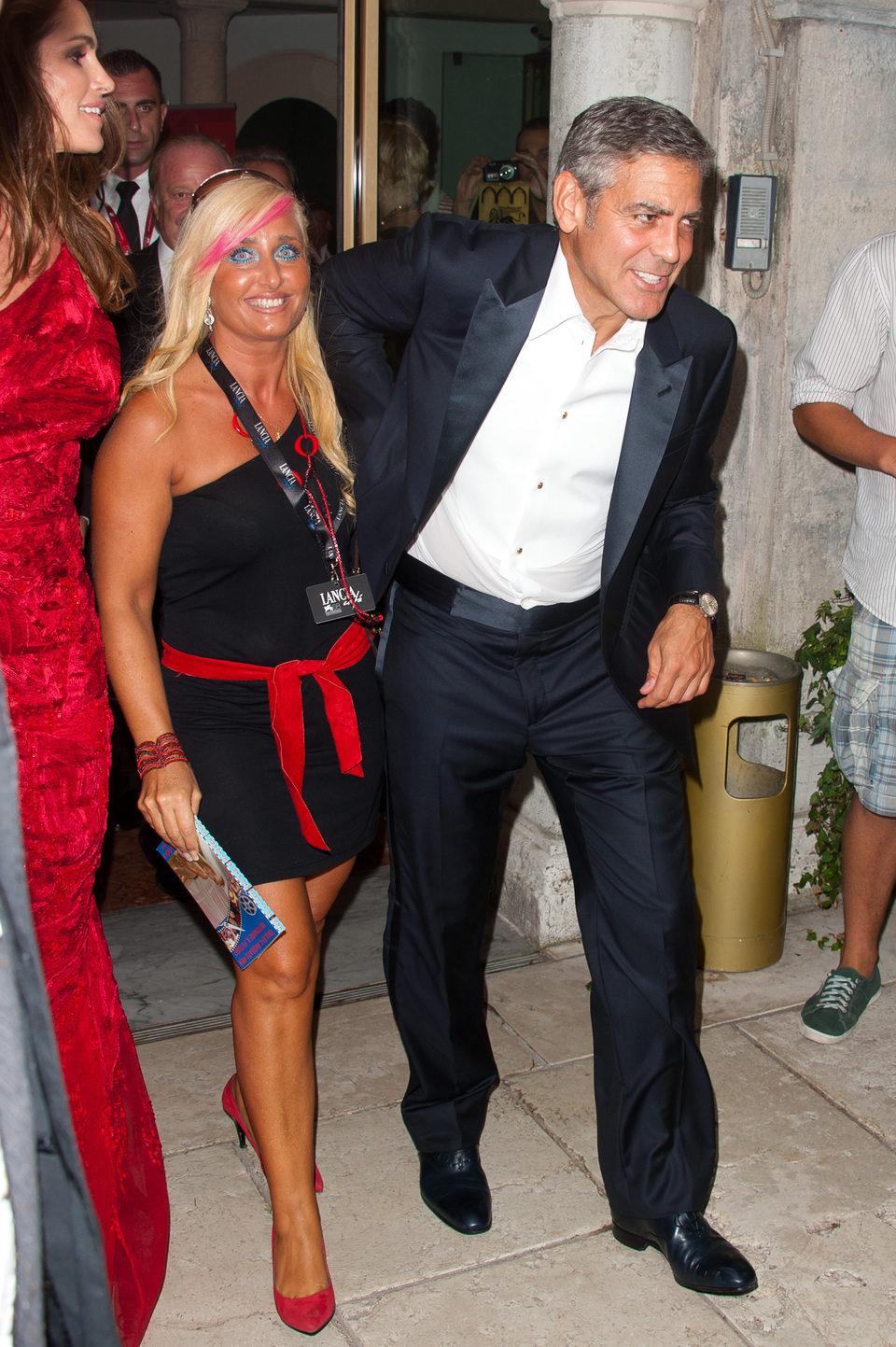 George Clooney y una fan que querría ser su próxima conquista
