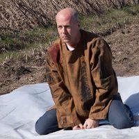 Bruce Willis magullado en 'Looper'