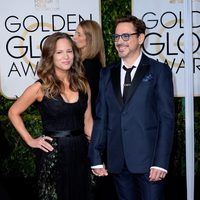 Robert Downey Jr. and Susan Downey at the Golden Globes 2015 red carpet