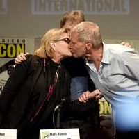 Carrie Fisher and Harrison Ford kiss at the 'Star Wars: The Force Awakens' panel at Comic-Con 2015