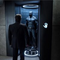 Bruce Wayne admires his suit for the first time