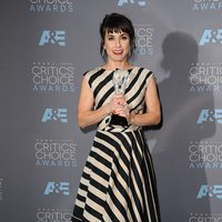 Constance Zimmer poses to photographers at 2016 Critics Choice Awards red carpet