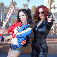 Harley Quinn and Black Widow Cosplay attend the Comic-Con International 2016