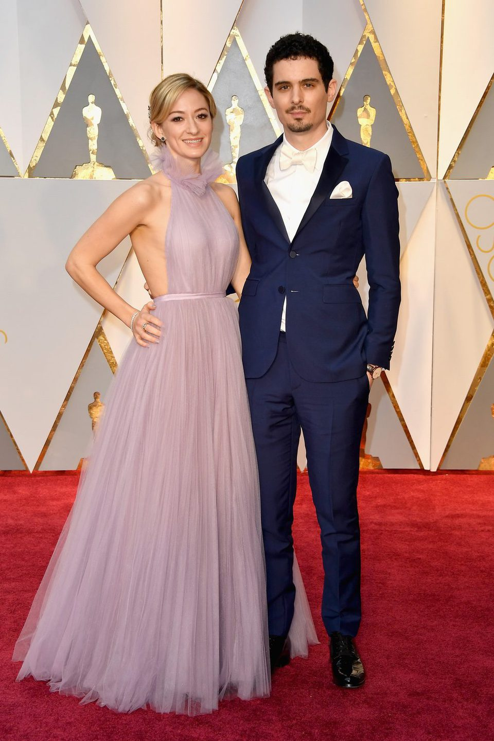 Damien Chazelle and Olivia Hamilton at the red carpet of the Oscars 2017