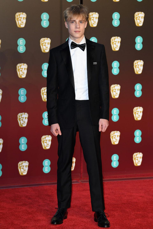 Tom Taylor en la alfombra roja de los BAFTA 2018