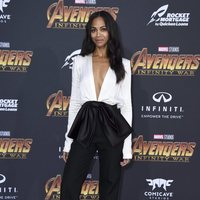 Zoe Saldana poses on the purple carpet at the world premiere of 'Aevengers: Infinity War'