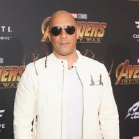 Vin Diesel poses on the purple carpet at the world premiere of 'Avengers: Infinity War'