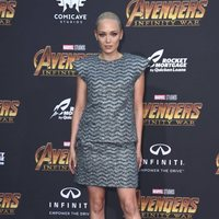 Pom Klemmentieff poses on the purple carpet at the world premiere of 'Avengers: Infinity War'