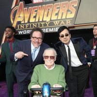 Stan Lee & Jon Favreau pose on the purple carpet at the world premiere of 'Avengers: Infinity War'