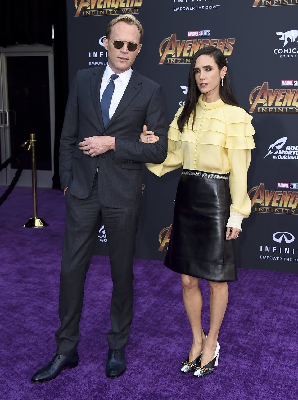 Paul Bettany & Jennifer Connelly pose on the purple carpet at the world premiere of 'Avengers: Infinity War'