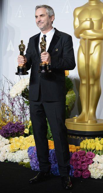 Alfonso Cuarón con sus Oscar 2014