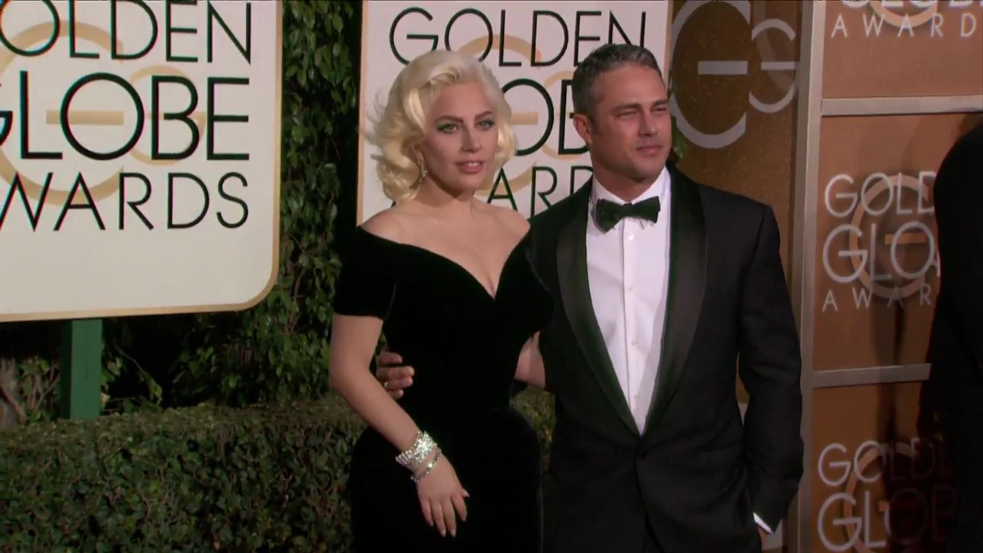 Elegante Lady Gaga con Taylor Kinney en la alfombra roja